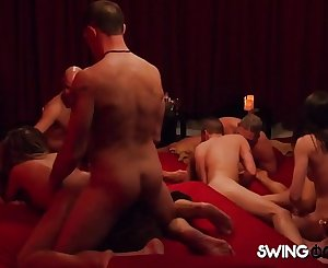 Alexis gets on the ground to play with other horny swingers