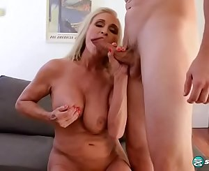Hot blonde granny fucking a young stud with big hard-on