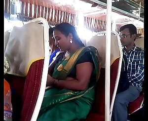Aunty in bus.. half-top nipple visible... Watch carefully 1